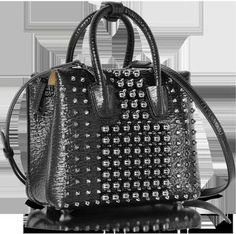 This MCM Black Mini Milla Pearl Studs Tote Bag has an all out glam attitude with a punk vibe.