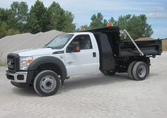 Ford F-450 Chassis with a KDBF-916A Rigid Side Dump Body with tapered Knap Pack, tarp, and amber lights   Knapheide