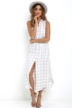 Make a brunch run in the BB Dakota Lance Grey Plaid Maxi Dress! Plaid print decorates woven rayon as it shapes this casual shirt dress with a collared neckline and relaxed fit. Button placket leads down to a chic, curved hem. Detachable sash belt.