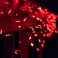 Vivid red icicle lights line the roof, creating a captivating display. Add red lights to Halloween decorations too!
