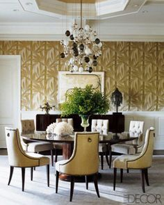 This Eclectic Neutral Dining Room Features White And Gold Patterned Chairs With Burnished Wood Trim Surrounding A Walnut Table Colorfu