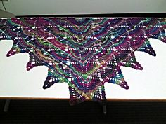 Strawberry Fields Forever Shawl - free crochet pattern by Douglas Hill. Triangular pineapple shawl.
