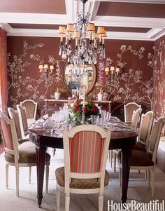 """An Alessandra Branca Design    """"I wanted the dining room to be a beautiful winter garden in the middle of downtown Chicago,"""" says designer Alessandra Branca. She designed the Fromental wallpaper for this room and painted the Louis XVI-style chairs covered in linen velvet and taffeta stripes to """"punch up the dark mahogany table."""""""