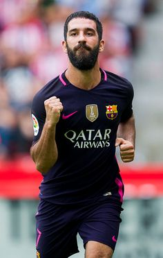 Arda Turan of FC Barcelona celebrates after scoring his team's fourth goal during the La Liga match between Real Sporting de Gijon and FC Barcelona at Estadio El Molinon on September 2016 in Gijon, Spain. Fc Barcelona, Barcelona Sports, Barcelona Players, Real Madrid Players, Barcelona Futbol Club, Soccer World, Champions League, Football Players, Professional Football