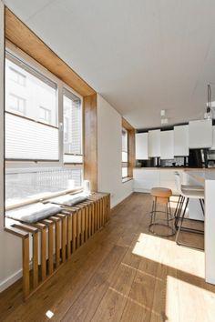 Radiator fairing living room windowsill wood panels wood flooring planks seat