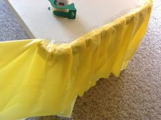"How to make a ""fancy ruffle"" table cloth from cheap dollar store plastic table cloths...I love this idea and you'd be surprised how nice it looks and wonder how did you ever NOT do this to your event tables as cheap as plastic table clothes are! I love using doilie, tissue and tulle to spice it up...so many options..."