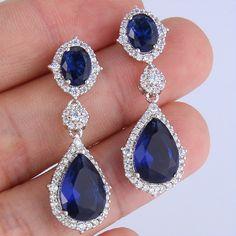 blue bridal earrings crystal teardrop earrings royal blue wedding earrings cubic zirconia earrings saphire blue crystal wedding earrings by FlowerRibbon on Etsy https://www.etsy.com/listing/247229148/blue-bridal-earrings-crystal-teardrop