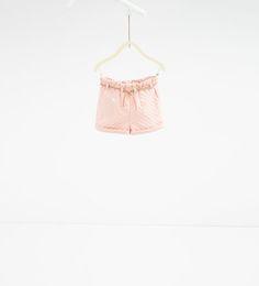 изображение 1 из Жаккардовые шорты в горошек от Zara