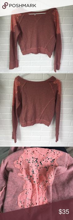 Free People Cropped Sweatshirt Free People cropped sweatshirt in excellent condition with cute lace detailing on arms. Free People Tops Sweatshirts & Hoodies