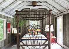 How fantastic is this bed for a rustic bedroom or vacation cabin? Reminds me of Washington with all our blackberry bushes. The bedding is from the iconic Hudson bay co.
