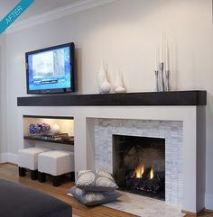 A nice modern fireplace - option to balance off center fireplace. Like tile - coordinates w kitchen MY NOTES - Like the footstools stored under tv. Fireplace still focus. Could I do this w/ my niche and fireplace on w/ neo traditional look? Living Room Decor Fireplace, Fireplace Tv Wall, Small Fireplace, Fireplace Remodel, Fireplace Surrounds, Fireplace Mantels, Fireplace Ideas, Living Room Layout With Fireplace And Tv, Fireplace Seating