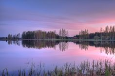 This is again from kyrkösjärvi. At last I had some time to go out with the camera at sunset. Red sunset sky and calm water make a nice mix. Now we have some colors :-)