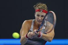 Yaroslava Shvedova Photos Photos - Yaroslava Shvedova of Kazakhstan returns a shot against Alize Cornet of France during the Women's singles third round match on day seven of the 2016 China Open at the China National Tennis Centre on October 7, 2016 in Beijing, China. - 2016 China Open - Day Seven