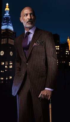 purple/brown combo with a bit of gold in the pocket square. No pinstripes