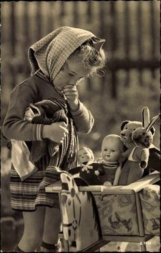 Cute vintage picture of child with dolls
