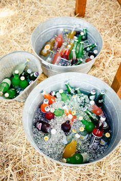 bottles in galvanized buckets