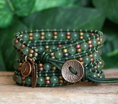 This four wrap bracelet features beautiful 6mm Aventurine Gemstone Beads, highlighted by Olive Rose Miyuki Seed Beads. Both are carefully ladder-stitched on to top quality Distressed Dark Green Leather. Known as a lucky stone, Aventurine is a variety of quartz. Green Aventurine is made