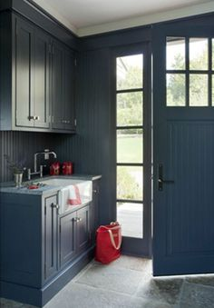 Paint all wood work, doors, trim and walls the same dark color in the mudroom. Great for cleaning, touching up, and making a small space look larger. For laundry room Interior Door Colors, Interior Door Trim, Painted Interior Doors, Black Interior Doors, Interior Paint, Interior Decorating, Interior Shop, Decorating Ideas, Paint Themes