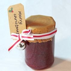 A jar of glitter jam with a paper cover and ribbon