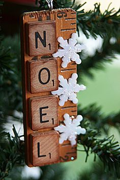 Amazing little ornaments made from pieces of yardstick, scrabble tiles, and plastic snowflakes.