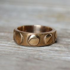"""The outside of this ring shows phases of the moon, while the inside is inscribed """"Take your time loving me."""" Swoon!"""