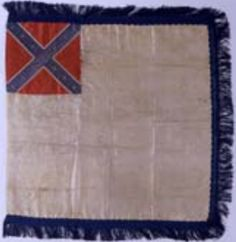 """Second National pattern miniature flag taken from Arlington (home of Robert E. Lee) during the war by William H. Johnson, 143rd New York Infantry, and sent to his father in New Jersey. The flag measures 16.5"""" x 17"""". Museum of the Confederacy Collection."""