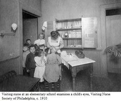 Visiting nurse at an elementary school examines a child's eyes, Visiting Nurse Society of Philadelphia, c.1910. Image courtesy of the Barbara Bates Center for the Study of the History of Nursing.