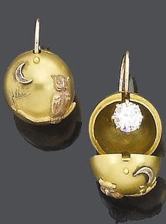 A pair of late 19th century novelty 'night and day' diamond pendent earrings, circa 1880. Each old brilliant-cut diamond within a claw setting, concealed by a removable spherical decorated gold case with applied owl motifs.