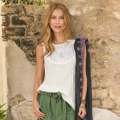 """FIREFLY TOP--Forgiving, relaxed crinkle rayon and intricate embroidered mesh yoke front and back make it easy to love this easy-fit top. Perfect for layering. Hand wash. Imported. Exclusive. Sizes XS (2), S (4 to 6), M (8 to 10), L (12 to 14), XL (16). Approx. 28-3/4""""L."""