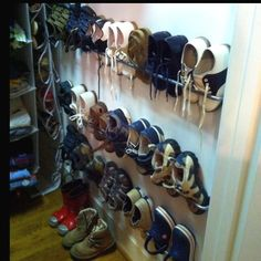 My boys' closet. Great way to organize shoes. Purchased towel bars from good ole' Ikea for less than $3.00 each!