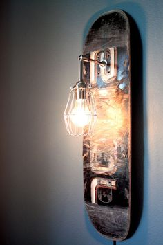 Useful Products Made From Repurposed Skateboards | Repurposed Skateboard Sconce Lamp