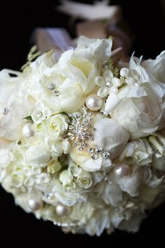Bridal Bouquet White - I love that there aren't just flowers in the bouquet.