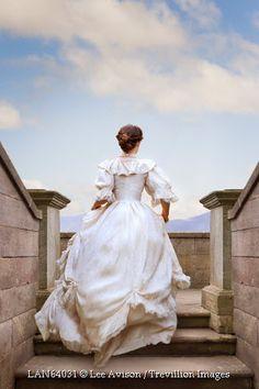 © Lee Avison / Trevillion Images - victorian-woman-running-up-stone-steps