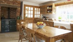 Beautiful Country Style Kitchens : Captivating Country Style Furniture In Country Kitchen With Fruit Bowl On Wooden Furnish Table And Chairs Exposed Brick Walls Also Kitchen Windows