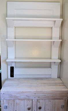 Shelf made from an old door.  Could adapt to the shelves i want for holding mason jars of bulk foods??
