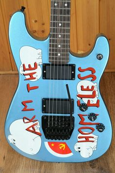 """Tom Morello """"Arm the Homeless"""" made in 1986 by Performance Guitar USA.  Stratocaster Alder body, Performance Corsair Neck, Seymour Duncan JB Pick Ups, and original Floyd Rose Tremolo System.  Tom hated the way the guitar played and changed ever component but the body."""