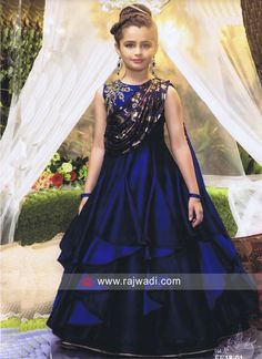 1fcb0c96933013 A Navy Blue designer layered style Gown made from Silk fabric. It is  adorned with