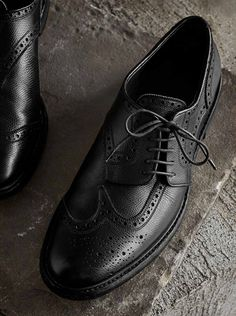 Timeless leather wingtip brogues, reworked with an asymmetric lace-up closure, playing on Henry Moore's abstract sculptures. Inspired by styles worn by the artist at work, grainy leather is stonewashed for a lived-in look.