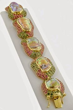 """Paula Crevoshay,- 18K yellow gold """"The Venus Bracelet"""" featuring freshwater baroque cultured Pearls (91.43 ctw.) accented with pink and green Tourmalines (29.32 ctw.). The Daily Jewel"""