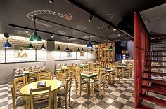 """Interior of """"Alaloum Board Game""""cafe was created by specialists from """"Triopton Architects""""studio.The theme of the interior are board games whatyou can"""