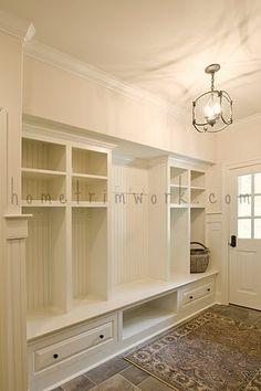 mud room storage idea- built ins with cubby holes for each person, shoe self, bench and maybe a pole for more coats instead of hooks (originally- hometrimwork.com)