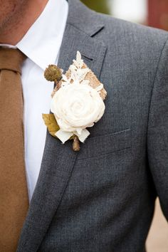 rustic boutonniere for the Groom Photography by aboutlovestudio.com. Love love love the color of this suit! Although I think Jesse and I both like browns better