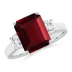 Love this Jewelry Style from Angara! Emerald Cut Garnet and Trapezoid Diamond Three Stone Ring