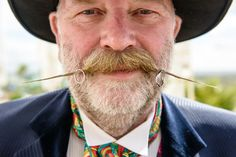 Wedding Rings on waxed moustache by Michael Wells Photography