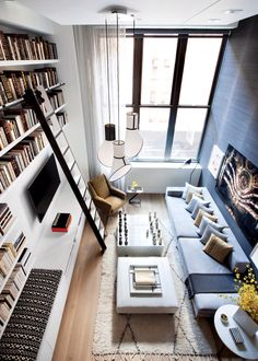 Beautiful loft library with ladder | Gravity Interior