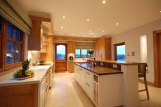 The long split-height island in contrasting colour to the rest of the kitchen looks beautiful