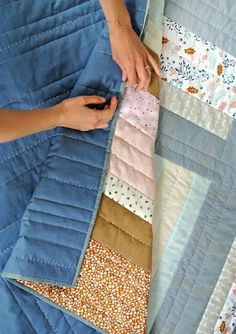 Putting the finishing touch on the Weekend Candy quilt - denim binding on a linen backing. yummm! This modern quilt pattern is available for instant PDF download!
