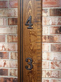 Wooden Growth Chart Ruler With Routed Edge - Walnut - Striped with Metal Numbers. $59.00, via Etsy.