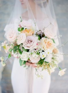 The prettiest rose bouquet: http://www.stylemepretty.com/little-black-book-blog/2016/07/14/style-meets-southern-charm-fashion-floral-filled-bridal-shoot/ | Photography: Julie Paisley - http://www.juliepaisley.com/