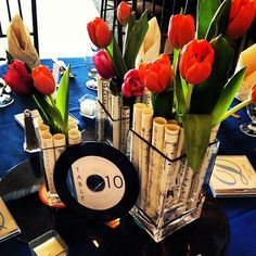 Musical wedding centerpieces, complete with tulips, sheet music, and recors! | Made by one of our preferred vendors, A Garden Party Florist